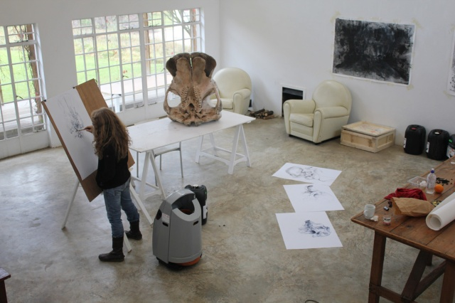 Diane Victor drawing the elephant skull in studio at Nirox Residency