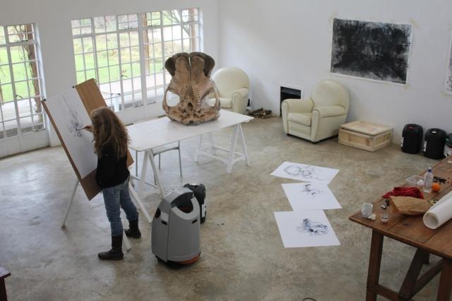 Diane Victor drawing the elephant skull in studio at Nirox Residency